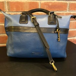 Fossil blue purse with shoulder strap.
